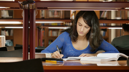 young-woman-studying-at-the-library-very-concentrated-dolly-uhd_vyfxx4ku__F0000