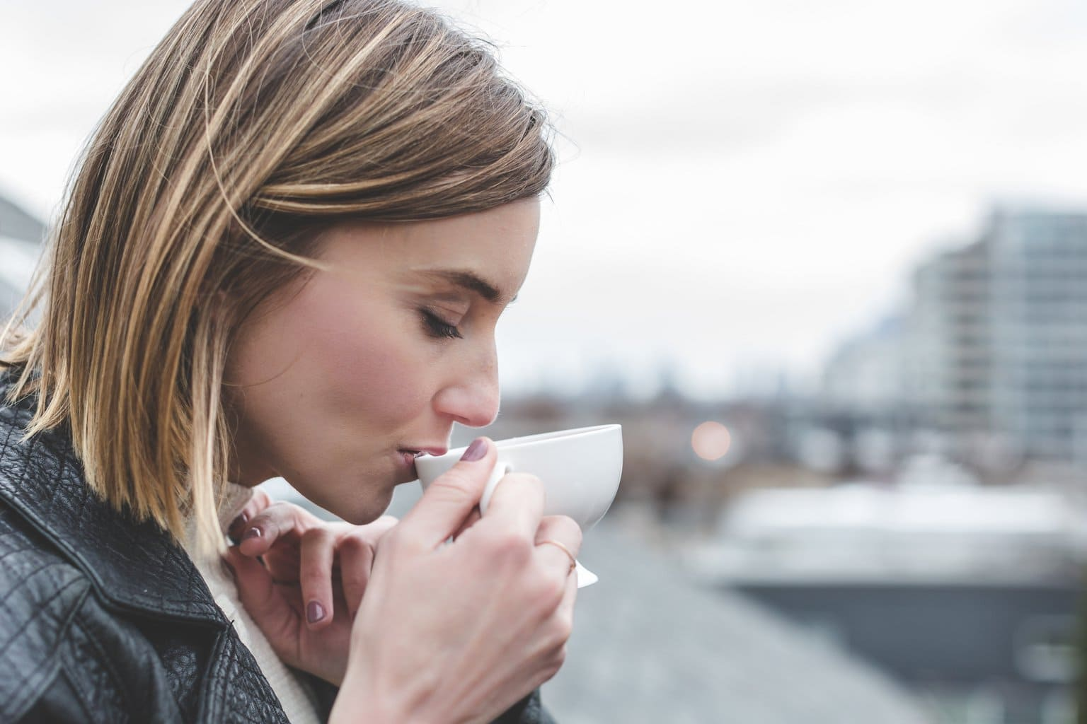 woman-drinking-coffee-rooftop