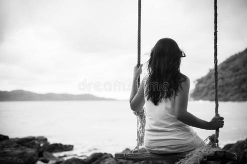 black-white-sad-lonely-woman-sitting-alone-wooden-swing-over-sea-black-white-sad-lonely-woman-119292494