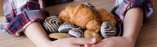 child-hoarding-cookies-and-croissants-1440x430