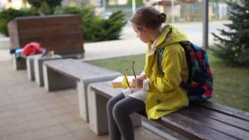 depositphotos_257483798-stock-video-lonely-girl-schoolgirl-sitting-on