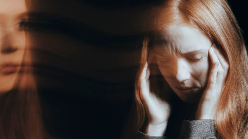 Young woman experiencing hallucinations