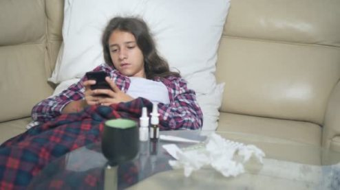 depositphotos_299862866-stock-video-sick-girl-holding-a-smartphone